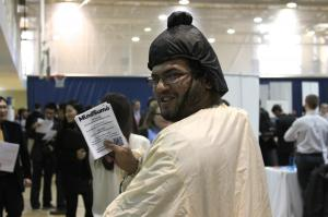 A student in Professor Kendrick's class dons the sumo costume during the JHU Career Fair.